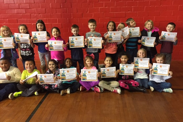 20 NES Students show off their Accelerated Reader Achievement Certificates